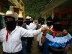 Zapatistas walking in couples