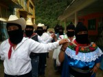 Zapatistas walking in couples