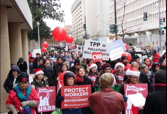 Anti-TPP march outside USTR on December 8, 2014. Photo by Elias Weston-Farber for Popular Resistance.