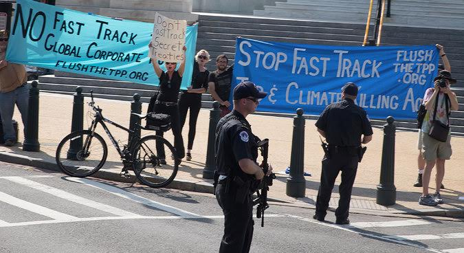 Fast Track protest June 12, 2015 as President Obama went into the House. Source NY Times.