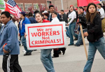 """Photo: """"We are workers, not criminals"""" was a theme at the Chicago May 1, 2006, immigrant and labor rights march. (swanksalot/CC/Flickr)"""